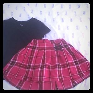 Justice girls black t-shirt and plaid skirt